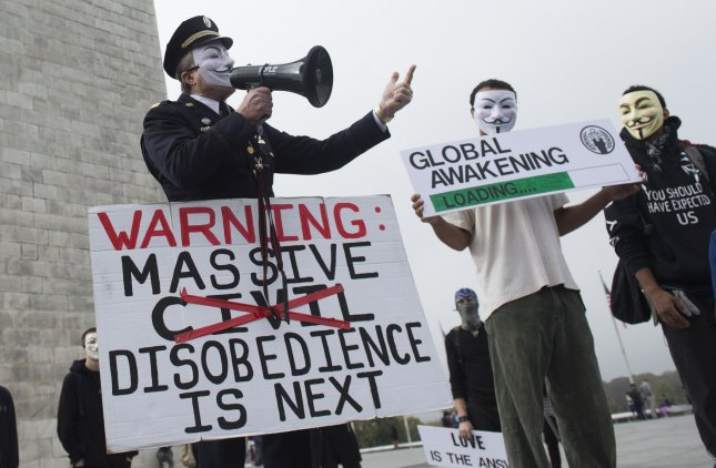 Demonstrators participated in the Million Mask March, an anti-establishment protest in over 670 cities worldwide, in Washington, D.C. on November 5, 2015. Two men associated with the march were arrested Saturday on charges of defacing government property. A third man who was carrying a gun and wearing a mask near the White House, also was arrested. Photo by Kevin Dietsch/UPI