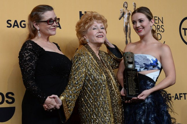 (L-R) Carrie Fisher, Debbie Reynolds, winner of the Screen Actors Guild lifetime award, and Billie Lourd pose backstage at the 21st annual SAG Awards held at the Shrine Auditorium in Los Angeles on January 25, 2015. Mother-daughter actresses Fisher and Reynolds both died this week. Photo by Jim Ruymen/UPI