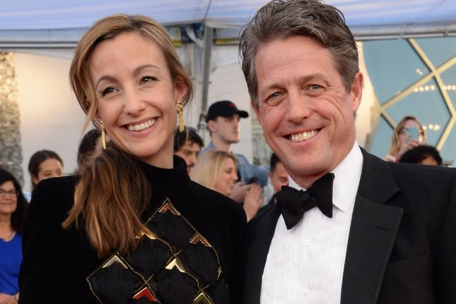 (L-R) Anna Eberstein and actor Hugh Grant arrive for the the 23rd annual SAG Awards on January 29. Grant appeared in Thursday's Red Nose Day Actually short film on NBC. File Photo by Jim Ruymen/UPI