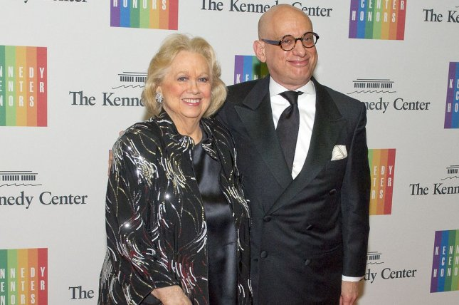 Barbara Cook and Adam LeGrant arrive for the formal Artist's Dinner honoring the recipients of the 2013 Kennedy Center Honors on Saturday, December 7, 2013. Cook died Tuesday at the age of 89. File Photo by Ron Sachs /Pool