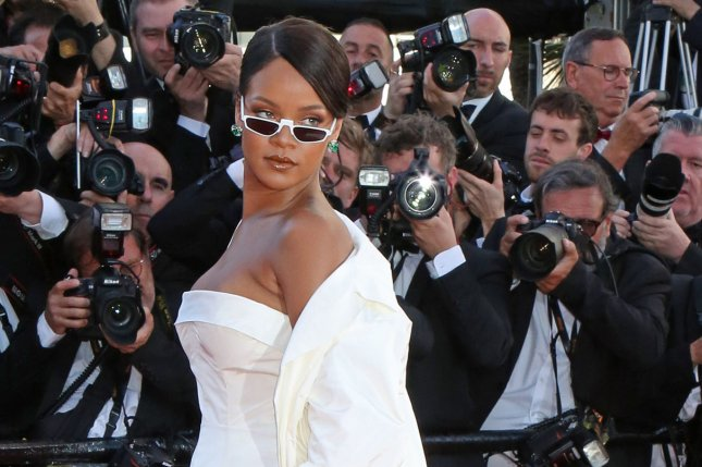 Rihanna arrives on the red carpet before the screening of the film Okja during the 70th annual Cannes International Film Festival in France on May 19. The singer has created a new makeup line called Fenty Beauty. File Photo by David Silpa/UPI