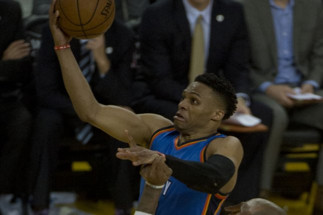 a4153e68b902 Oklahoma City Thunder point guard Russell Westbrook lays up the ball  against the Golden State Warriors in the third quarter of Game 5 of the NBA  Western ...