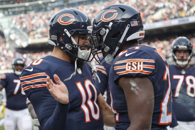 Chicago Bears running back Jordan Howard (24) celebrates with quarterback Mitchell Trubisky (10) after scoring a touchdown against the Green Bay Packers during the first half on Sunday at Soldier Field in Chicago. Photo by Kamil Krzaczynski/UPI