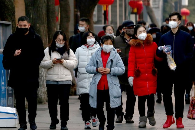 People are wearing protective respiratory masks in Beijing amid the ongoing 2019-nCoV outbreak. Photo by Stephen Shaver/UPI