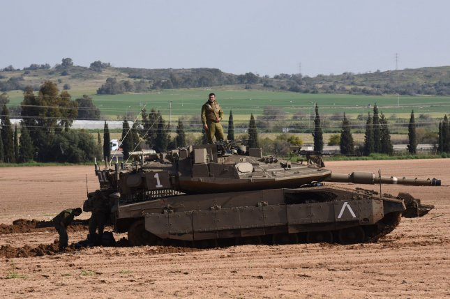 Israeli tanks shelled two Hamas military posts Saturday, in what Israel describes as retaliation for a rocket fired by Palestinians earlier that day. In this March 2019 file photo, Israeli soldiers work on a Merkava tank at a staging area along the Israel-Gaza border, in southern Israel. Photo by Debbie Hill/UPI