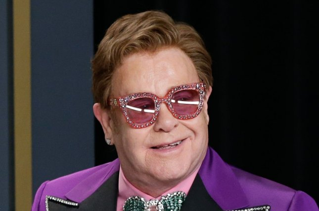 Ailing Elton John had to leave his New Zealand concert early on Sunday. File Photo by John Angelillo/UPI