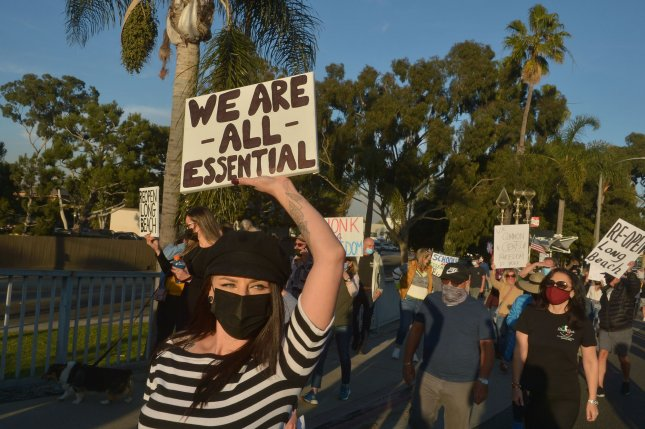 Residents protest new COVID-19 restrictions in California for restaurants that were ordered as a response to dramatic rises in coronavirus cases, on the Pacific Coast Highway in Long Beach, Calif., on Wednesday. Photo by Jim Ruymen/UPI
