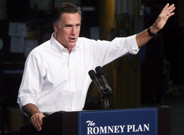 Presumptive Republican presidential nominee Mitt Romney waves to supporters after delivering a speech at Acme Industries August 7, 2012 in Elk Grove Village, Illinois. Romney was in President Barack Obama's home state for two fundraisers in advance of the November 4 general election. UPI Photo/Frank Polich