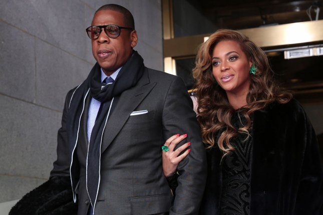 Recording artists Jay-Z and Beyonce arrive before the presidential inauguration on the West Front of the U.S. Capitol January 21, 2013 in Washington, DC. (File/UPI/Win McNamee/POOL)