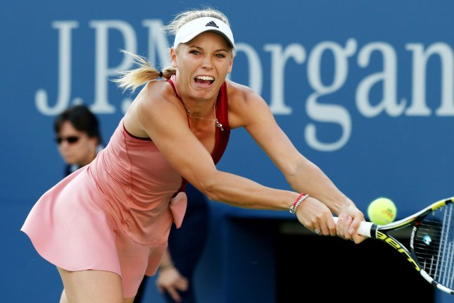 Caroline Wozniacki of Denmark returns the ball to Serena Williams of the USA in the first set of their finals match of the US Open at the USTA Billie Jean King National Tennis Center in New York City on September 7, 2014. Williams won 6-3, 6-3. UPI/Monika Graff