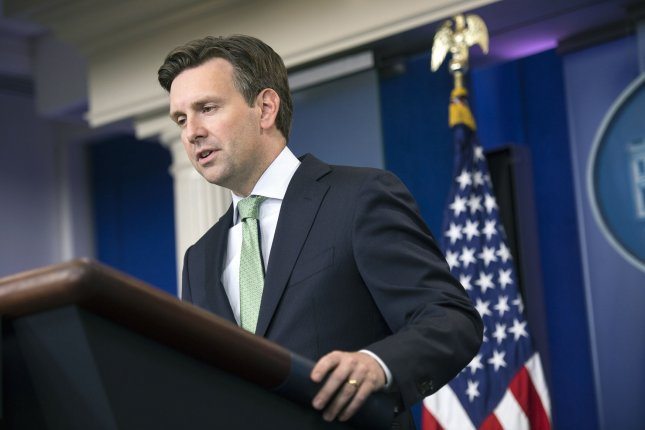 White House Press Secretary Josh Earnest holds the daily press briefing at the White House in Washington, D.C., Friday, Sept. 18, 2015. Earnest announced that the departments of Commerce and Treasury will remove a series of restrictions on Americans traveling to and doing business with Cuba, which will take effect Monday. Photo by Kevin Dietsch/UPI