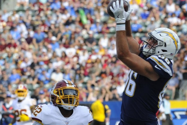 Los Angeles Chargers tight end Hunter Henry catches a pass for a touchdown in the first half against as Washington Redskins' Deshazor Everett watches on December 10 at StuHub Center in Carson, Calif. Photo by Lori Shepler/UPI