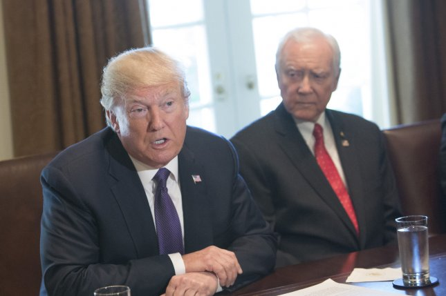 President Donald Trump (left) appears with U.S. Sen. Orrin Hatch, R-Utah, during a meeting with members of the Senate Finance Committee and his economic team at the White House on October 18. Hatch was named as one of seven recipients of the Presidential Medal of Freedom to be awarded Friday in the White hose. Photo by Chris Kleponis/UPI