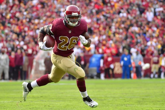 Washington Redskins running back Adrian Peterson (26) is now tied with Jim  Brown for fifth all-time in career rushing touchdowns. Photo by Kevin  Dietsch UPI ... 97844c63a
