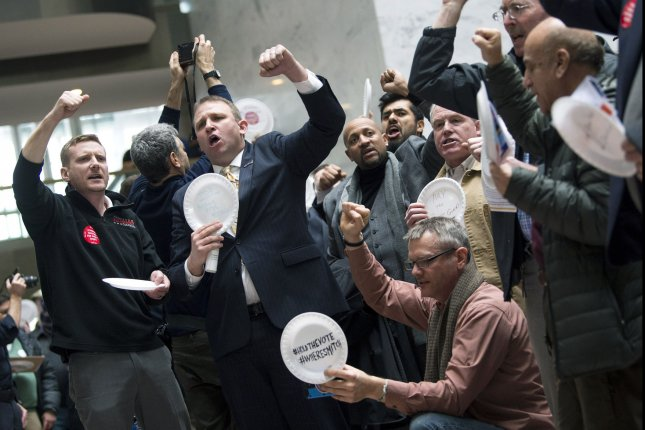 Furloughed government workers protest the federal shutdown in a demonstration on Capitol Hill Wednesday. Photo by Kevin Dietsch/UPI