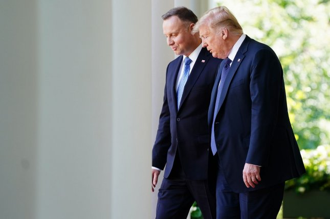 Polish President Andrzej Duda, L, met with U.S. President Donald Trump, R, at the White House in June. File Photo by Jim Lo Scalzo/UPI