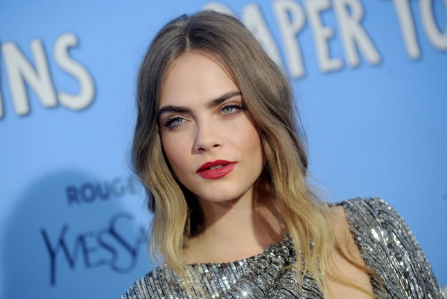 Cara Delevingne at the New York premiere of 'Paper Towns' on July 21. The model recently went nearly nude for YSL Beauty. File photo by Dennis Van Tine/UPI