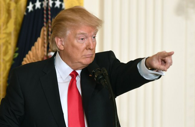 President Donald Trump holds a news conference in the East Room at the White House on Thursday. Pat Benic/UPI