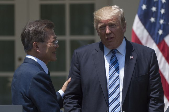 South Korean President Moon Jae-in (L) and U.S. President Donald Trump take part a joint statement in the Rose Garden at the White House on June 30. The two leaders plan to meet again in Seoul, South Korea, in November. File Photo by Molly Riley/UPI