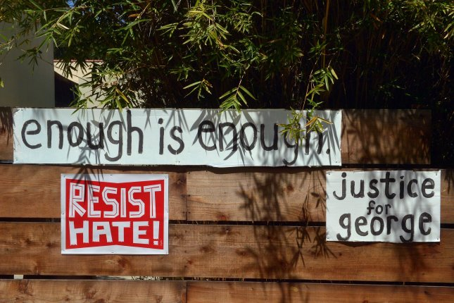 Signs with messages against excessive police force and inequality are seen on a house in Los Angeles, Calif., on June 10, 2020. File Photo by Jim Ruymen/UPI