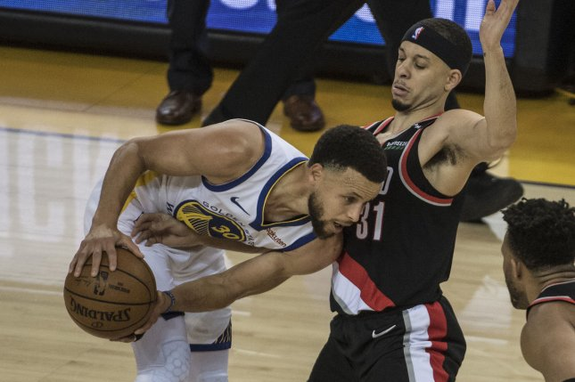 Golden State Warriors guard Stephen Curry (L) is scheduled to become an unrestricted free agent after the 2021-22 season. File Photo by Terry Schmitt/UPI