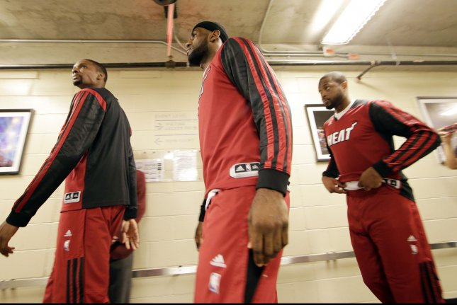 Miami Heat Chris Bosh, LeBron James and Dwyane Wade walk to the court to before the game against the Brooklyn Nets in Game 4 of the Eastern Conference Semifinals at Barclays Center in New York City on May 12, 2014. UPI/John Angelillo