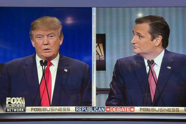 Republican presidential candidates Donald Trump (L) and Sen. Ted Cruz (R-TX) are seen on television screens in the media room at the Republican presidential debate in North Charleston, South Carolina on January 14, 2016. Photo by Kevin Dietsch/UPI