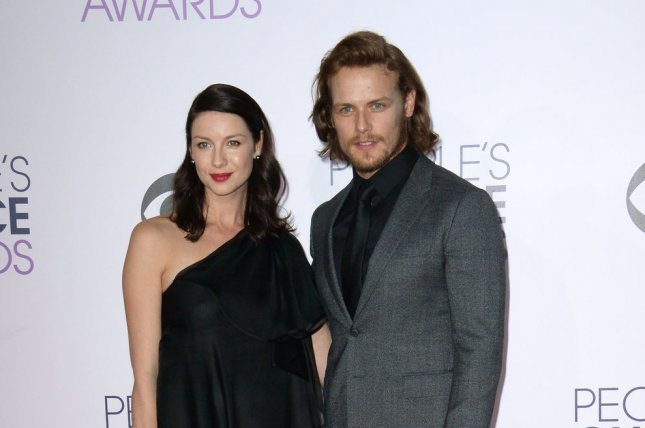 Outlander stars Caitriona Balfe and Sam Heughan arrive for the 41st annual People's Choice Awards in Los Angeles on January 7, 2015. File photo by Jim Ruymen/UPI