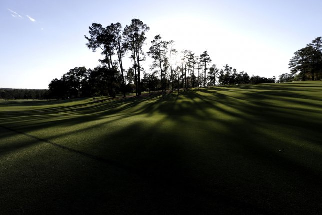 The sun sets behind the first hole fairway after a practice round on Tuesday at the 2017 Masters Tournament at Augusta National Golf Club in Augusta, Georgia on April 4, 2017. Photo by John Angelillo/UPI