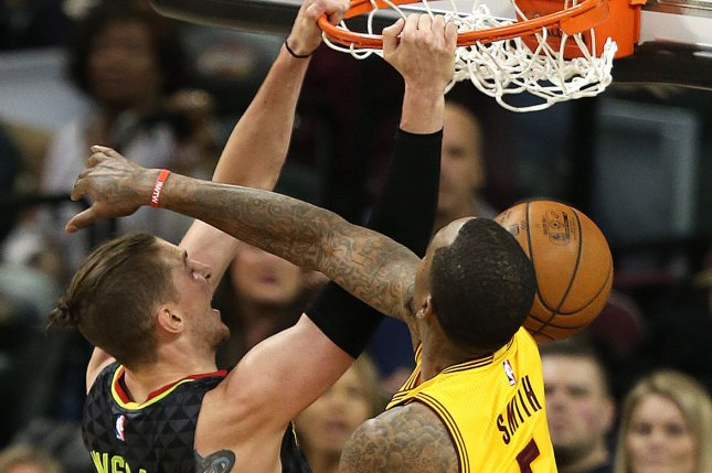 Atlanta Hawks Mike Muscala dunks over Cleveland Cavaliers' J.R. Smith during the second half at Quicken Loans Arena in Cleveland on April 7, 2017. Photo by Aaron Josefczyk/UPI