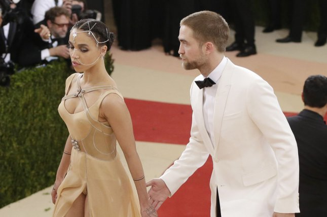 Robert Pattinson (R) and FKA twigs attend the Costume Institute Benefit at the Metropolitan Museum of Art on May 2, 2016. The actor addressed his status with FKA twigs this week. File Photo by John Angelillo/UPI