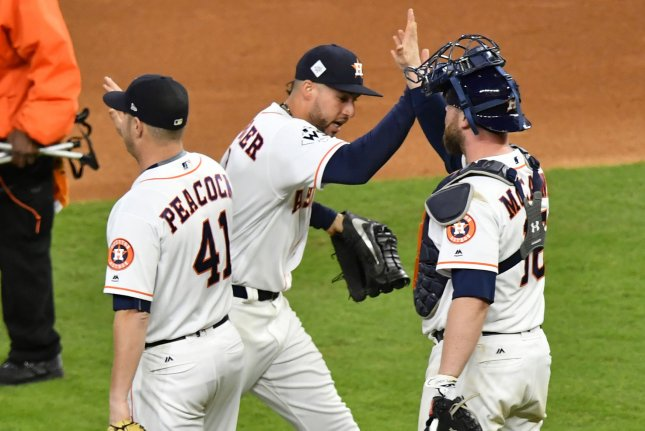 Houston Astros George Springer (C) high fives reliever Brad Peacock and catcher Brian McCann after defeating the Los Angeles Dodgers in the 2017 MLB World Series game three at Minute Maid Park in Houston, Texas on October 27, 2017. The Astros beat the Dodgers 5-3 to take a 2-1 best of seven game series lead. Photo by David Tulis/UPI