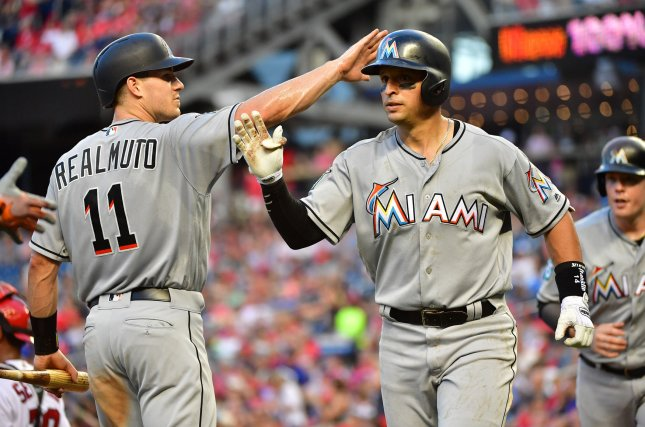 Martin Prado (R) and the Miami Marlins square off with the Philadelphia Phillies on Sunday. Photo by Kevin Dietsch/UPI