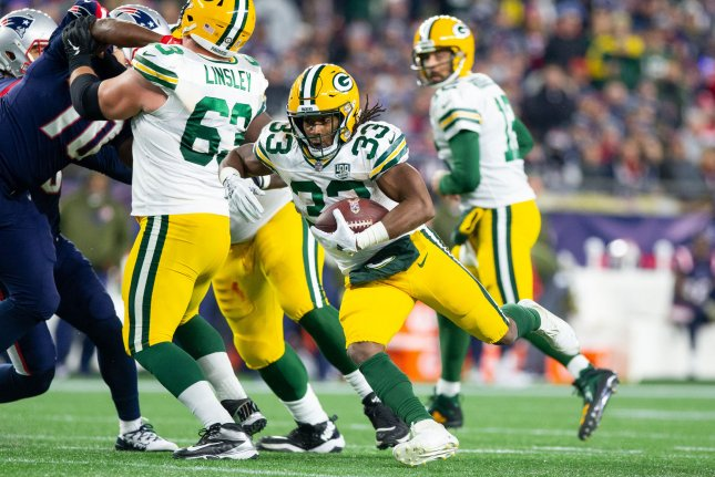 Green Bay Packers running back Aaron Jones (33) charges up the field on a carry in the second quarter against the New England Patriots on November 4, 2018 at Gillette Stadium in Foxborough, Massachusetts. Photo by Matthew Healey/UPI