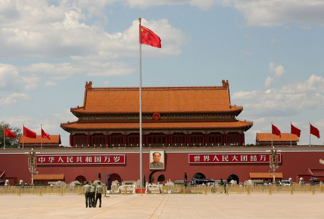 Soldiers take photos in an empty Tiananmen Square as the Chinese People's Political Consultative Conference gets underway in Beijing on May 27, 2020. Photo by Stephen Shaver/UPI