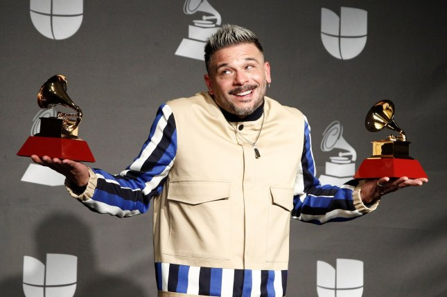 Pedro Capo appears backstage with his awards at the 20th annual Latin Grammys in Las Vegas on November 14. This year's Latin Grammys will be a virtual ceremony, airing on Univision on Nov. 19. File Photo by James Atoa/UPI