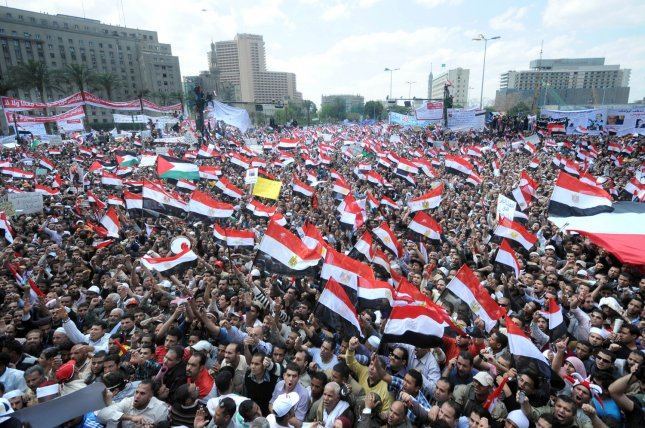 Egyptian protesters shout slogans demanding faster reforms during a demonstration at Cairo's Tahrir Square on April 8, 2011 in Cairo, Egypt. The cell phone firm Vodafone is being criticized for posturing that it played a role in the revolution. UPI