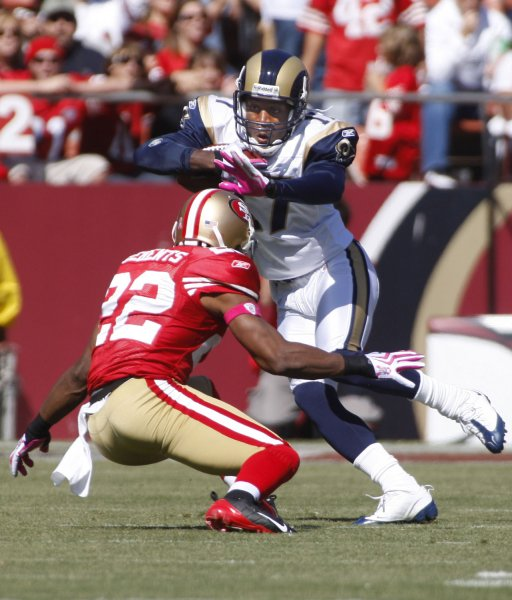 af1ff5a0f5e St. Louis Rams WR Donnie Avery (R) tries to fend off San Francisco 49ers  Nate Clements in the first half at Candlestick Park in San Francisco on  October 4