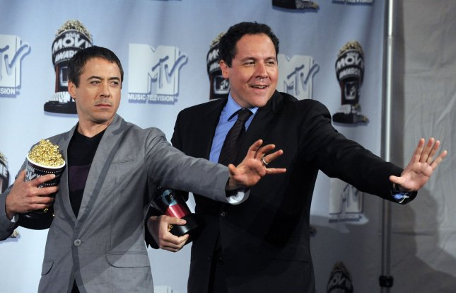 Actor Robert Downey Jr. (L) star of the film Iron Man and the film's director Jon Favreau appear with their Best Summer Movie So Far award backstage at the 2008 MTV Movie Awards in Los Angeles on June 1, 2008. (UPI Photo/Jim Ruymen)