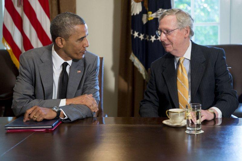 U.S. President Barack Obama, left, talks to Senate Minority Leader Mitch McConnell, R-Ky. UPI/Andrew Harrer/Pool