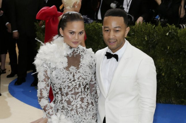 Chrissy Teigen (L) and John Legend attend the Costume Institute Benefit at the Metropolitan Museum of Art on May 1. The model smooched Legend while dressed as Spider-Man on Sunday's episode of Lip Sync Battle. File Photo by John Angelillo/UPI