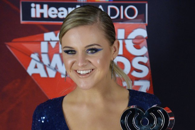 Kelsea Ballerini, winner of the Best New Country Artist award appears backstage at the iHeartRadio Music Awards on March 5. The singer has joined the lineup of performers for the ACM Honors ceremony this month. File Photo by Jim Ruymen/UPI