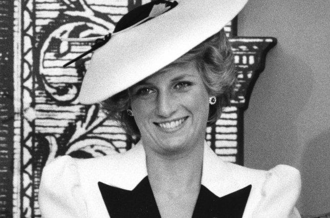 Princess Diana responds to reporters' questions after she and her then-husband Prince Charles toured the National Gallery of Art on November 10, 1985. Princess Diana's sons, Prince William and Prince Harry, plan to observe the 20th anniversary of her death with a small ceremony at her former home, Kensington Palace. File Photo by Doug Mills/UPI