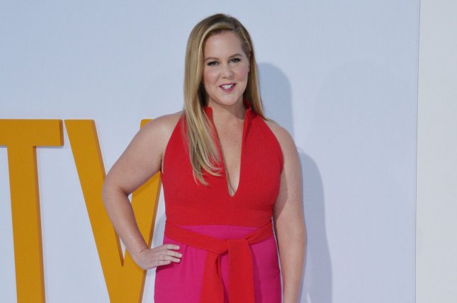 Cast member Amy Schumer attends the premiere of I Feel Pretty at theWestwood Village Theatre in the Westwood section of Los Angeles on April 17. Schumer will guest host Saturday Night Live next month. Photo by Jim Ruymen/UPI