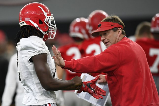 Georgia Bulldogs head coach Kirby Smart (R) performs hands-on instruction during practice for the NCAA football National Championship Game on January 6, 2018 in Athens, Georgia. Photo by David Tulis/UPI