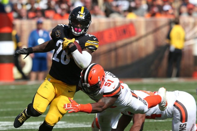 Pittsburgh Steelers running back Le'Veon Bell (26) runs through the grasp of Cleveland Browns linebacker James Collins Sr. during the second half on September 10, 2017 at First Energy Stadium in Cleveland. Photo by Aaron Josefczyk/UPI