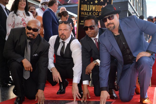 Members of the Latino-American hip-hop group Cypress Hill Senen Sen Dog Reyes, Lawrence DJ Muggs Muggerud, Eric Bobo Correa and Louis B-Real Freese pose with their star on the Hollywood Walk of Fame. Photo by Jim Ruymen/UPI