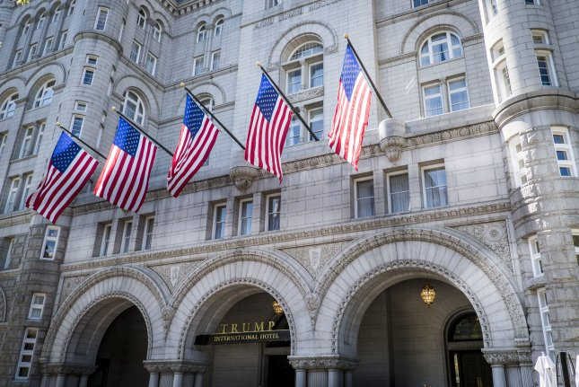 A group of 200 Democrats say President Donald Trump is violating the emoluments clause by profiting from foreign governments' use of his businesses, like Trump International Hotel in Washington, D.C.. File Photo by Pete Marovich/UPI