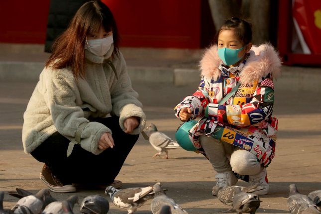 Chinese wear protective respiratory masks in Beijing, China, on Wednesday. Photo by Stephen Shaver/UPI