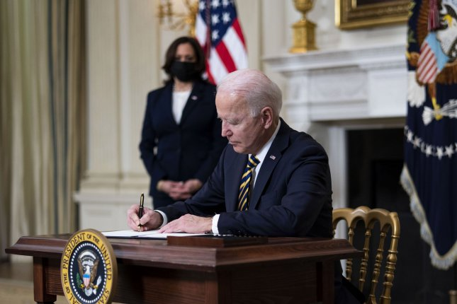 President Joe Biden signs an executive order Wednesday calling for a review of supply chains across federal agencies in the wake of shortages of essential goods ranging from medical equipment to computer chips. Pool Photo by Doug Mills/UPI